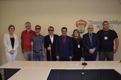 Equipe de trabalho reunida na Frente Parlamentar em Defesa dos Direitos da Pessoa com Deficiência