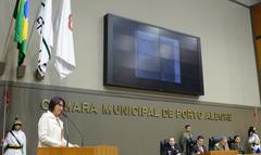 Presidente Valter Nagelstein preside Sessão Solene em homenagem aos 100 anos do Tribunal de Justiça Militar do Estado do Rio Grande do Sul. Na foto, a vereadora Comandante Nádia na tribuna.