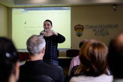 Palestra e Treinamento do SEI. Na foto, a Autora e Gestora Nacional do SEI, Patrícia Valentina.